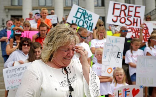 (AP Photo/Rick Bowmer, File). FILE - In this July 30, 2016, file photo, Laurie Holt, the mother of Joshua Holt, an American jailed in Venezuela, cries during a rally at the Utah State Capitol, in Salt Lake City. A secret backchannel has opened up in 20...