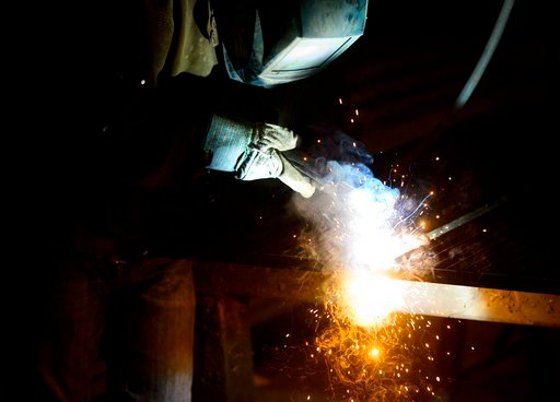 (Sean Kilpatrick/The Canadian Press via AP). A welder fabricates a steel structure at an iron works facility in Ottawa, Ontario, Monday, March 5, 2018.
