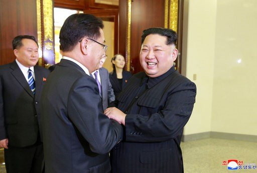 (Korean Central News Agency/Korea News Service via AP). In this Monday, March 5, 2018, photo, provided by the North Korean government on March 6, North Korean leader Kim Jong Un, front right, meets South Korean National Security Director Chung Eui-yong...