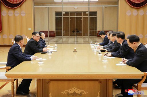 (Korean Central News Agency/Korea News Service via AP). In this Monday, March 5, 2018, photo, provided by the North Korean government on March 6, North Korean leader Kim Jong Un, second left, meets members of the South Korean delegation.