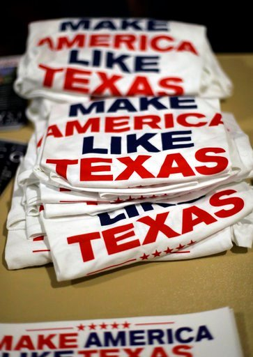 (AP Photo/Eric Gay). In this Tuesday, Feb. 13, 2018, photo, campaign T-shirts are stacked on a table at a Republican congressional candidate forum, in New Braunfels, Texas. Texas holds the nation's first 2018 primary elections Tuesday, March 6, 2018, a...