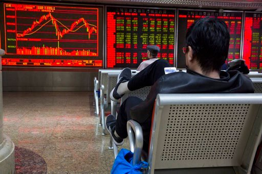 (AP Photo/Ng Han Guan). Chinese investors monitor stock market prices displayed at a brokerage in Beijing, Tuesday, March 6, 2018. Asian stock markets surged Tuesday despite U.S.-Chinese trade tensions after Wall Street posted its strongest gains in a ...