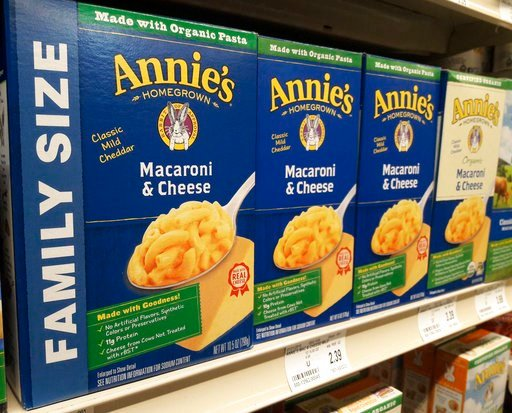 (AP Photo/Steve Karnowski). Boxes of Annie's Macaroni & Cheese are shown on the shelf at a supermarket in Edina, Minn., Sunday, March 4, 2018. Annie's is an organic and natural unit of food industry giant General Mills, which announced a deal Tuesd...