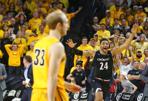 (Travis Heying/The Wichita Eagle via AP). Cincinnati forward Kyle Washington (24) celebrates after Wichita State guard Conner Frankamp (33) missed a three-point basket that would have won an NCAA college basketball game in the American Athletic Confere...