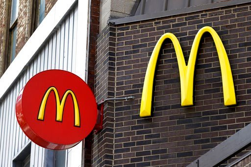 (AP Photo/Keith Srakocic, File). In this April 24, 2017, photo, corporate signage hangs at a McDonald's restaurant in downtown Pittsburgh. McDonald's announced Tuesday that it is offering fresh beef rather than frozen patties in some locations.