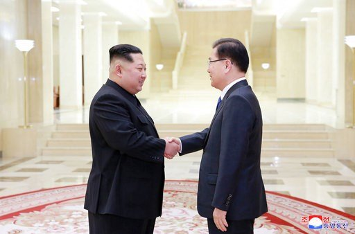 (Korean Central News Agency/Korea News Service via AP). In this Monday, March 5, 2018 photo, provided by the North Korean government on March 6, North Korean leader Kim Jong Un, left, shakes hands with South Korean National Security Director Chung Eui-...