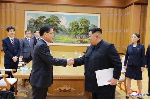 (Korean Central News Agency/Korea News Service via AP). In this Monday, March 5, 2018 photo, provided by the North Korean government on March 6, North Korean leader Kim Jong Un, front right, shakes hands with South Korean National Security Director Chu...