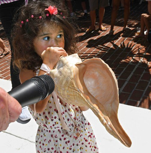 (Rob O'Neal/Florida Keys News Bureau via AP). In this photo provided by the Florida Keys News Bureau, Charlotte Jackson, 3, blows a horse conch shell during the annual Conch Shell Blowing Contest Saturday, March 3, 2018, in Key West, Fla. Judges evalua...