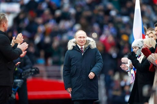 (AP Photo/Pavel Golovkin). Russian President Vladimir Putin arrives to attend a massive rally in his support as a presidential candidate at the Luzhniki stadium in Moscow, Russia, Saturday, March 3, 2018.