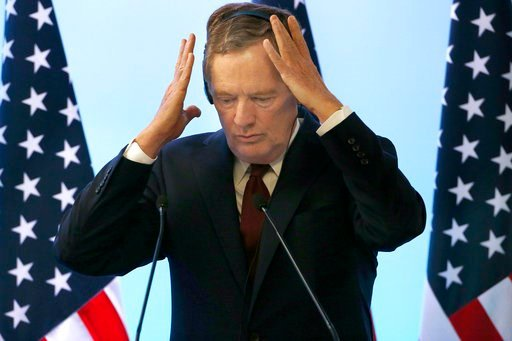 (AP Photo / Marco Ugarte). U.S. Trade Representative Robert Lighthizer adjusts his headsead during a press conference regarding the seventh round of NAFTA renegotiations in Mexico City, Monday, March 5, 2018.