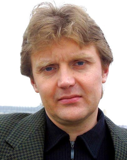 """(AP Photo/File). FILE - In this Friday May 10, 2002 file photo Alexander Litvinenko, former KGB spy and author of the book """"Blowing Up Russia: Terror From Within"""", is photographed at his home in London.   Former KGB agent who defected to Britain and be..."""