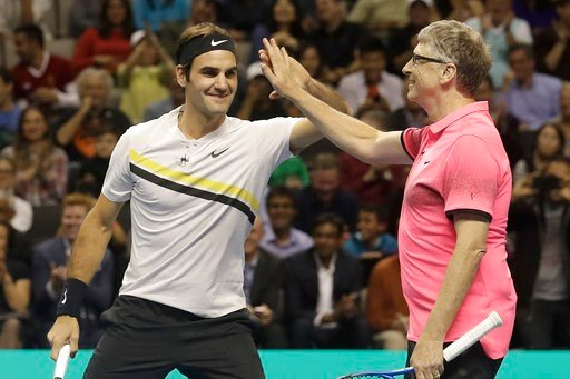 (AP Photo/Jeff Chiu). Roger Federer, of Switzerland, left, celebrates with partner Bill Gates as they play an exhibition tennis match against Jack Sock and Savannah Guthrie in San Jose, Calif., Monday, March 5, 2018.