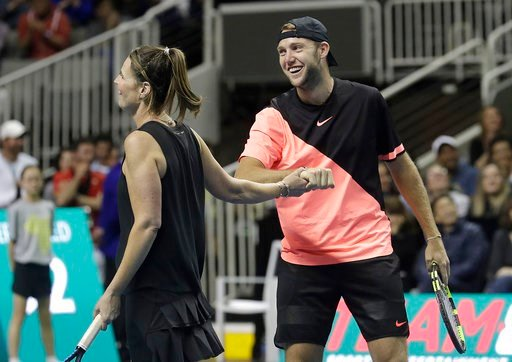 (AP Photo/Jeff Chiu). Savannah Guthrie, left, and partner Jack Sock celebrate during an exhibition tennis match against Roger Federer and Bill Gates in San Jose, Calif., Monday, March 5, 2018.