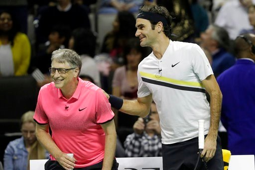 (AP Photo/Jeff Chiu). Roger Federer, of Switzerland, right, smiles after he and partner Bill Gates played in an exhibition tennis match against Jack Sock and Savannah Guthrie in San Jose, Calif., Monday, March 5, 2018.