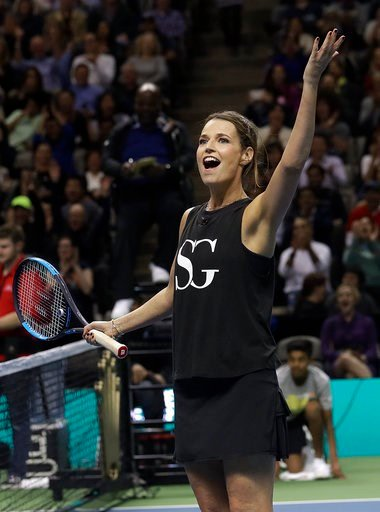 (AP Photo/Jeff Chiu). Savannah Guthrie waves during an exhibition tennis match with partner Jack Sock against Roger Federer and Bill Gates in San Jose, Calif., Monday, March 5, 2018.