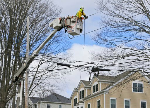 (AP Photo/Seth Wenig). Charlie Ruff with Jersey Central Power and Light works to repair power lines in Morristown, N.J., Monday, March 5, 2018. Tens of thousands of New Jersey residents remain without power and emergency officials are watching coastal ...