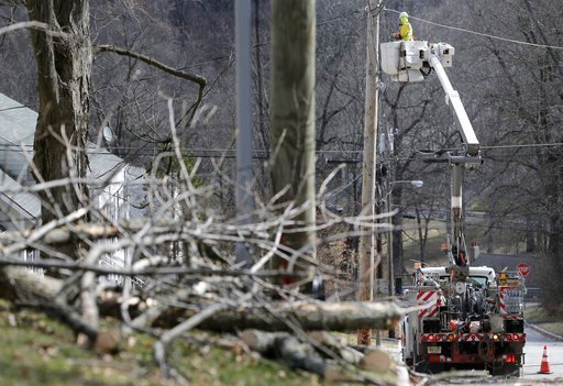 (AP Photo/Seth Wenig). A man works on power lines in Morristown, N.J., Monday, March 5, 2018. Tens of thousands of New Jersey residents remain without power and emergency officials are watching coastal areas for flooding following a powerful storm.