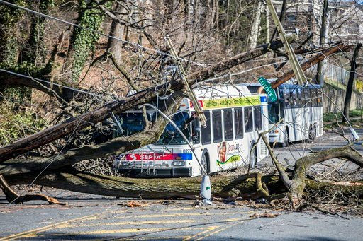 (Michael Bryant/The Philadelphia Inquirer via AP). CORRECTS LOCATION TO PHILADELPHIA FROM BRYAN MAWR; - A bus is covered by a tree that collapsed onto power lines due to a storm last Friday in Philadelphia, Sunday, March 4, 2018. The road is closed unt...