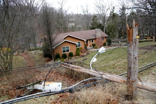 (AP Photo/Seth Wenig). Downed power lines and telephone poles are seen in Morristown, N.J., Monday, March 5, 2018. Tens of thousands of New Jersey residents remain without power and emergency officials are watching coastal areas for flooding following ...