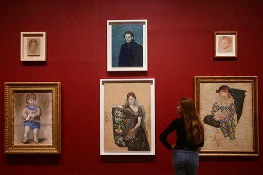 (Yui Mok/PA via AP). A woman looking at various portraits by Pablo Picasso, during a preview of the exhibition Picasso 1932 - Love, Fame, Tragedy at Tate Modern in London, Tuesday March 6, 2018.  The first ever solo Pablo Picasso exhibition remains at ...