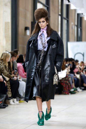 (Photo by Vianney le Caer/Invision/AP). Kaia Gerber wears a creation for Miu Miu ready-to-wear fall/winter 2018/2019 fashion collection in Paris, Tuesday, March 6, 2018.
