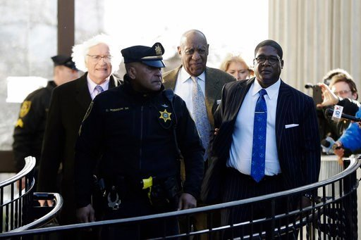 (AP Photo/Matt Slocum). Bill Cosby, center, departs a pretrial hearing in his sexual assault case at the Montgomery County Courthouse, Monday, March 5, 2018, in Norristown, Pa. Cosby made his first court appearance of the #MeToo era on Monday as defens...