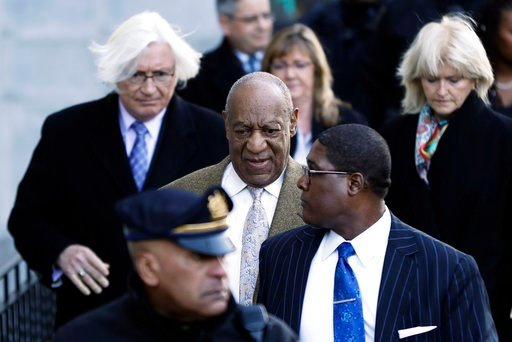 (AP Photo/Matt Slocum). Bill Cosby, center, departs a pretrial hearing in his sexual assault case at the Montgomery County Courthouse, Monday, March 5, 2018, in Norristown, Pa.