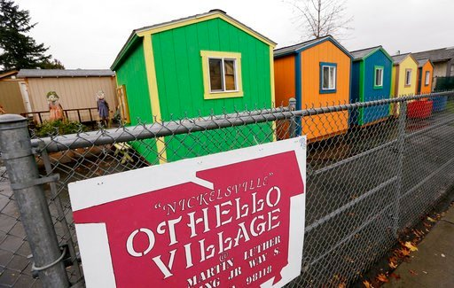 (AP Photo/Elaine Thompson, File). FILE - In this Thursday, Nov. 9, 2017, file photo, a line of tiny houses stand with their backs to the adjacent street at a homeless encampment in Seattle. In the absence of legislation to incentivize the acceptance of...
