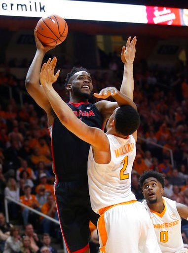 (AP Photo/Crystal LoGiudice). Georgia forward Yante Maten looks for a shot over Tennessee forward Grant Williams (2) during the first half of an NCAA college basketball game Saturday, March 3, 2018, in Knoxville, Tenn.