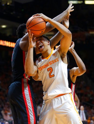 (AP Photo/Crystal LoGiudice). Tennessee forward Grant Williams (2) is defended under the basket by Georgia forward Yante Maten, left, during the second half of an NCAA college basketball game Saturday, March 3, 2018, in Knoxville, Tenn. Tennessee won 6...
