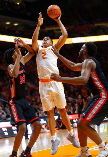 (AP Photo/Crystal LoGiudice). Tennessee forward Grant Williams (2) is defended under the basket by Georgia forwards Nicolas Claxton (33) and Yante Maten during the second half of an NCAA college basketball game Saturday, March 3, 2018, in Knoxville, Te...