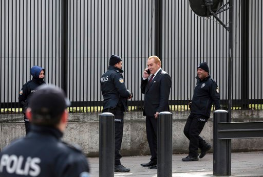 (AP Photo/Burhan Ozbilici). Turkish security members check the ID of a man as they stand outside the U.S. embassy in Ankara, Turkey, Monday, March 5, 2018. Turkish police detained four Islamic State suspects as part of an investigation into a possible ...