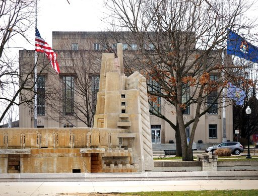 (Mark Bugnaski/Kalamazoo Gazette-MLive Media Group via AP). This May 5, 2018 photo shows the Fountain of the Pioneers in Bronson Park in Kalamazoo, Mich.   The Kalamazoo City Commission voted 5-1 early Tuesday, March 6,  following a meeting that began ...
