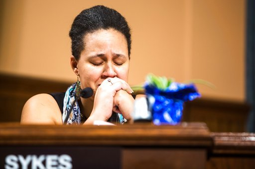 (Rebekah Welch/Kalamazoo Gazette-MLive Media Group via AP). Kalamazoo City Commissioner Shannon Sykes closes her eyes as she tears up when Mayor Bobby Hopewell says he will vote in favor of removing the Fountain of the Pioneers from Bronson Park, a cau...