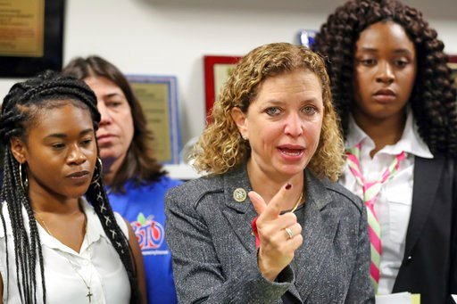 (Amy Beth Bennett/South Florida Sun-Sentinel via AP). U.S. Rep. Debbie Wasserman Schultz ticks off points on her fingers as she speaks during a news conference at her office in Sunrise, Fla., on Monday, March 5, 2018. The Congresswoman organized a roun...