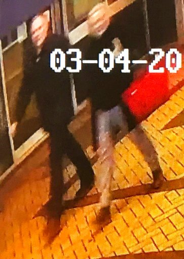 (AP Photo). In this image taken from security camera footage from PA  shows a man and woman as they walk through an alleyway connecting a Zizzi's restaurant to a bench where  former Russian double agent Sergei Skripal was found in Salisbury on Sunday M...