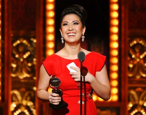"(Photo by Charles Sykes/Invision/AP, File). FILE - In this June 7, 2015 file photo, Ruthie Ann Miles accepts the award for best performance by an actress in a featured role in a musical for ""The King & I"" at the 69th annual Tony Awards in New York...."