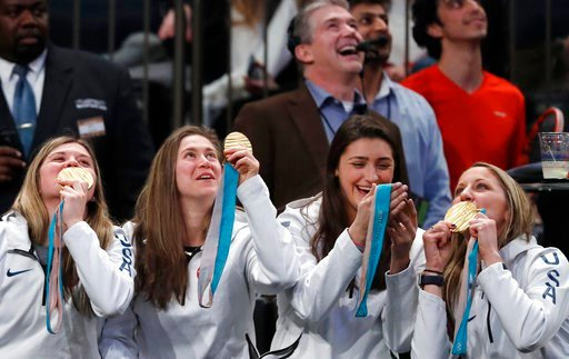 (AP Photo/Kathy Willens). Several members of the USA women's hockey team clown around with their gold medals as they watch the Tie Break Tens tennis tournament at Madison Square Garden, Monday, March 5, 2018 in New York. The Tie Break Tens' New York ev...