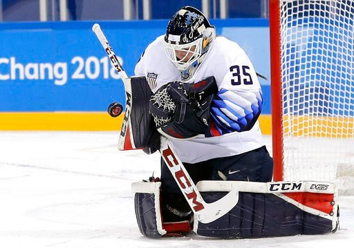 (AP Photo/Frank Franklin II, File). CORRECTS MONTH OF SHOW TO MARCH, NOT FEB. - FILE - In this Feb. 11, 2018, file photo, United States' goalie Maddie Rooney blocks a shot during the first period of the preliminary round of the women's hockey game agai...
