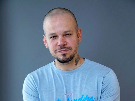(Photo by Amy Sussman/Invision/AP). In this Nov. 9, 2017 file photo, Puerto Rican rapper Residente, founder of the group Calle 13, poses for a portrait in New York. Residente will receive the BMI Champion Award at the BMI Latin Awards this month. The p...