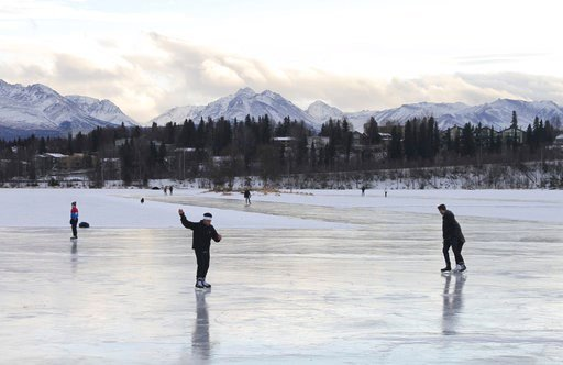 (AP Photo/Mark Thiessen, File). FILE - In this Jan. 2, 2018, file photo, ice skaters take advantage of unseasonable warm temperatures to ice skate outside at Westchester Lagoon in Anchorage, Alaska. New U.S. weather data shows that the Arctic just fini...