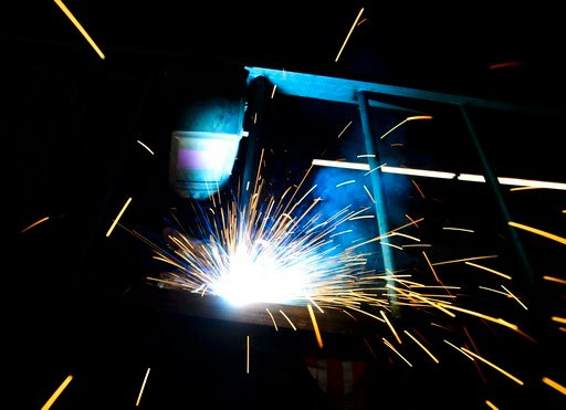 """(Sean Kilpatrick/The Canadian Press via AP). A welder fabricates a steel structure at an iron works facility in Ottawa, Ontario, Monday, March 5, 2018. President Donald Trump insisted Monday that he's """"not backing down"""" on his plan to impose stiff tari..."""