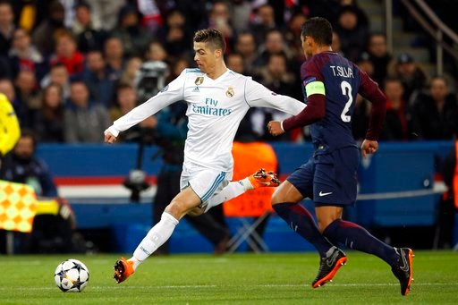 (AP Photo/Francois Mori). Real Madrid's Cristiano Ronaldo, left, makes an attempt to shot the ball as PSG's Thiago Silva tries to stop him during the round of 16, 2nd leg Champions League soccer match between Paris Saint-Germain and Real Madrid at the ...