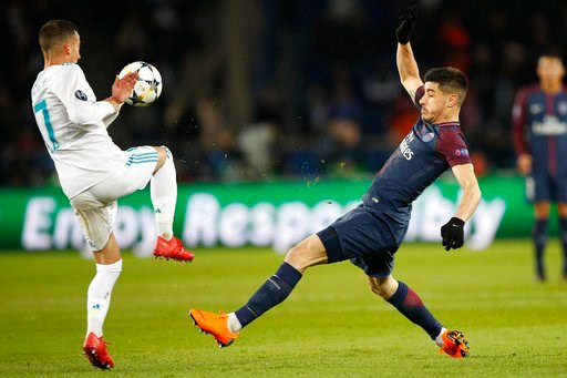 (AP Photo/Christophe Ena). Real Madrid's Lucas Vazquez, left, and PSG's Yuri Berchiche vie for the ball during the Champions League round of sixteen second leg soccer match between Paris St. Germain and Real Madrid at the Parc des Princes stadium in Pa...