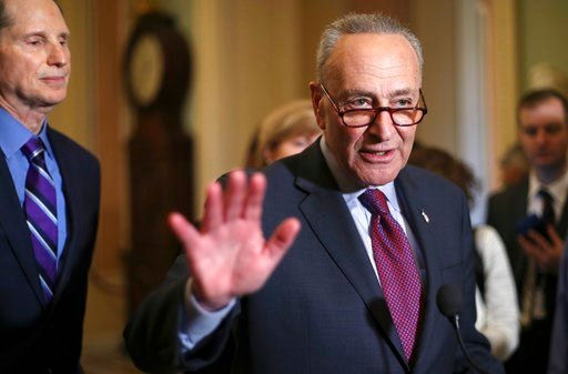 (AP Photo/Pablo Martinez Monsivais). Senate Minority Leader Chuck Schumer of N.Y., right, speaks to reporters following weekly policy luncheons to answer questions on Capitol Hill in Washington, Tuesday, March 6, 2018. Watching is Sen. Ron Wyden, D-Ore...