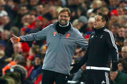 (AP Photo/Dave Thompson). Liverpool coach Jurgen Klopp talks with the fourth official, right, during the Champions League round of 16, second leg, soccer match between Liverpool and FC Porto at Anfield Stadium, Liverpool, England, Tuesday March 6, 2018.