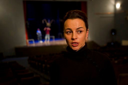 "(AP Photo/Visar Kryeziu). Playwright Jelena Bogavac speaks prior the start of a musical dubbed The ""Lift: Slobodan Show"" about late Serbian strongman Slobodan Milosevic premiered Tuesday, March 6, 2018, before a packed theatre in Gracanica, a Serb popu..."