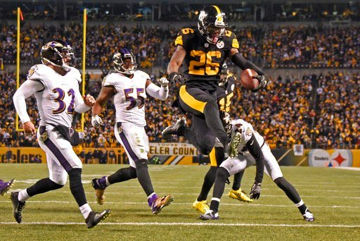 (AP Photo/Don Wright, File). FILE - In this Dec. 25, 2016, file photo, Pittsburgh Steelers running back Le'Veon Bell (26) leaps into the end zone ahead of Baltimore Ravens strong safety Eric Weddle (32) for a touchdown during the second half of an NFL ...