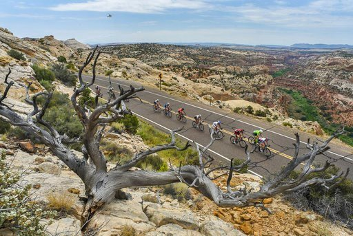 (Francisco Kjolseth/The Salt Lake Tribune via AP, File). FILE - In this Aug. 2, 2016, file photo, cyclists race along the scenic Byway 12 above Calf Creek and the Grand Staircase-Escalante National Monument beyond during the second stage of the Tour Of...