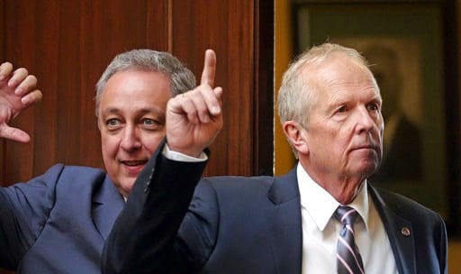 (AP Photo/Rick Bowmer). Rep. Mike Noel, right, R-Kanab, votes on the House Floor at the Utah State Capitol Tuesday, March 6, 2018, in Salt Lake City. A plan to name a Utah highway after President Donald Trump is getting a nod of approval from Utah lawm...
